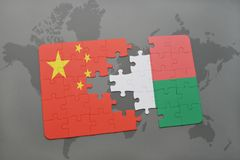 Puzzle with the national flag of china and madagascar on a world map background. 3D illustration Royalty Free Stock Photography
