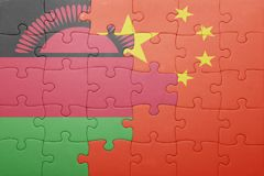 Puzzle with the national flag of china and malawi. Concept Stock Images