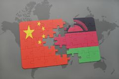 Puzzle with the national flag of china and malawi on a world map background. 3D illustration Stock Photography