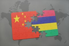 Puzzle with the national flag of china and mauritius on a world map background. 3D illustration Royalty Free Stock Photos
