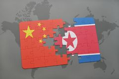 Puzzle with the national flag of china and north korea on a world map background. 3D illustration royalty free stock photography