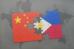 puzzle with the national flag of china and philippines on a world map background. Royalty Free Stock Photos