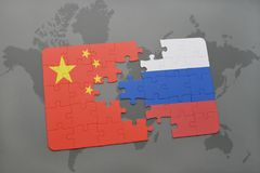 Puzzle with the national flag of china and russia on a world map background. 3D illustration royalty free stock photography