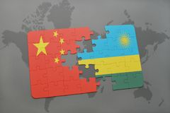 Puzzle with the national flag of china and rwanda on a world map background. 3D illustration royalty free stock images