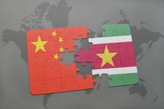 Puzzle with the national flag of china and suriname on a world map background. 3D illustration Royalty Free Stock Image