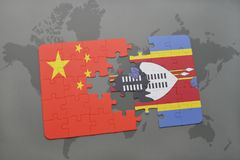 Puzzle with the national flag of china and swaziland on a world map background. 3D illustration Stock Photo