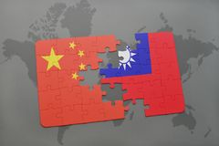 Puzzle with the national flag of china and taiwan on a world map background. 3D illustration royalty free stock photo