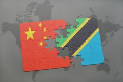Puzzle with the national flag of china and tanzania on a world map background. 3D illustration Royalty Free Stock Photo
