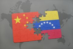 Puzzle with the national flag of china and venezuela on a world map background. 3D illustration stock photos