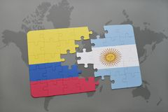 Puzzle with the national flag of colombia and argentina on a world map background. Royalty Free Stock Images