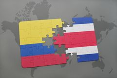 puzzle with the national flag of colombia and costa rica on a world map background. Stock Photos