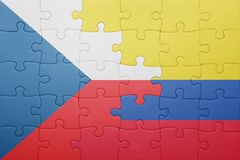 Puzzle with the national flag of colombia and czech republic Royalty Free Stock Photo