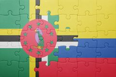 Puzzle with the national flag of colombia and dominica. Concept stock image