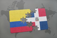 puzzle with the national flag of colombia and dominican republic on a world map background. Stock Photo