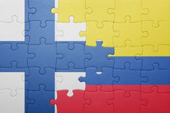 Puzzle with the national flag of colombia and finland Royalty Free Stock Image