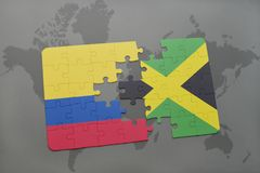 Puzzle with the national flag of colombia and jamaica on a world map background. 3D illustration stock image