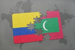 Puzzle with the national flag of colombia and maldives on a world map. Background. 3D illustration Royalty Free Stock Photos