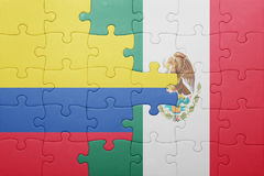 Puzzle with the national flag of colombia and mexico. Concept royalty free stock photography