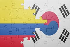 Puzzle with the national flag of colombia and south korea. Concept stock photography