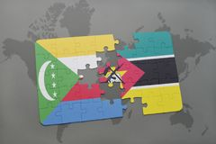 Puzzle with the national flag of comoros and mozambique on a world map. Background. 3D illustration Stock Images