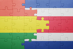 Puzzle with the national flag of costa rica and bolivia. Concept Royalty Free Stock Photography