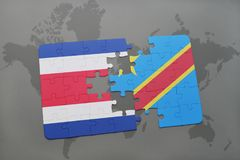 puzzle with the national flag of costa rica and democratic republic of the congo on a world map Stock Photos
