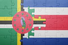 Puzzle with the national flag of costa rica and dominica. Concept stock photos