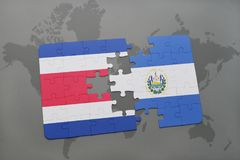 puzzle with the national flag of costa rica and el salvador on a world map background. Stock Photos