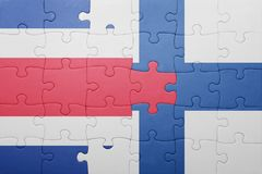 Puzzle with the national flag of costa rica and finland Stock Photography