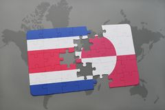 puzzle with the national flag of costa rica and greenland on a world map background. Stock Images