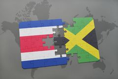 puzzle with the national flag of costa rica and jamaica on a world map background. Royalty Free Stock Photos