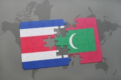 Puzzle with the national flag of costa rica and maldives on a world map. Background. 3D illustration Royalty Free Stock Photo