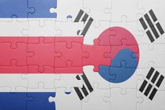 Puzzle with the national flag of costa rica and south korea. Concept royalty free stock image