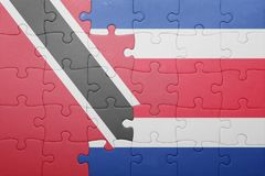 Puzzle with the national flag of costa rica and trinidad and tobago Stock Images