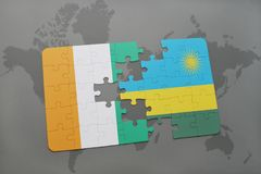 Puzzle with the national flag of cote divoire and rwanda on a world map. Background. 3D illustration Royalty Free Stock Photography