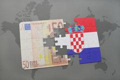 Puzzle with the national flag of croatia and euro banknote on a world map background. 3D illustration Stock Photo