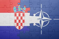 Puzzle with the national flag of croatia and nato Stock Images