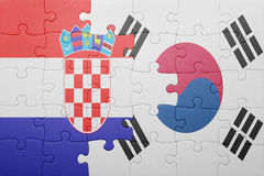 Puzzle with the national flag of croatia and south korea. Concept royalty free stock image