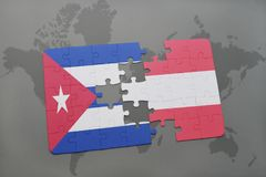 Puzzle with the national flag of cuba and austria on a world map background. 3D illustration Stock Photography