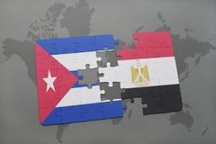 Puzzle with the national flag of cuba and egypt on a world map background. 3D illustration stock photo
