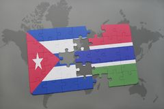 Puzzle with the national flag of cuba and gambia on a world map background. 3D illustration royalty free stock photos