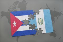 Puzzle with the national flag of cuba and guatemala on a world map background. 3D illustration royalty free stock photography