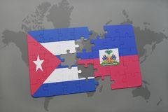 Puzzle with the national flag of cuba and haiti on a world map background. 3D illustration royalty free stock images