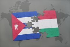 Puzzle with the national flag of cuba and hungary on a world map background. 3D illustration stock images