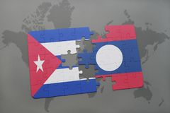 Puzzle with the national flag of cuba and laos on a world map background. 3D illustration royalty free stock photos