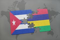 Puzzle with the national flag of cuba and mauritius on a world map background. 3D illustration royalty free stock photography