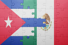 Puzzle with the national flag of cuba and mexico. Concept royalty free stock photo