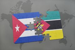 Puzzle with the national flag of cuba and mozambique on a world map background. Royalty Free Stock Images