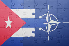 Puzzle with the national flag of cuba and nato Stock Photography