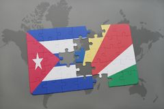 Puzzle with the national flag of cuba and seychelles on a world map background. 3D illustration stock photos